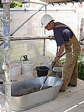 Andrew Newcombe mixing mortar