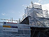 scaffolding and signs