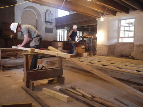 George and Christoph laying the timber floor  framework in the East Church, Cromarty
