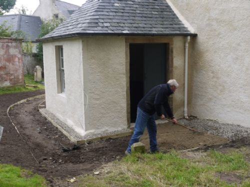 raking the path at the East Church, Cromarty