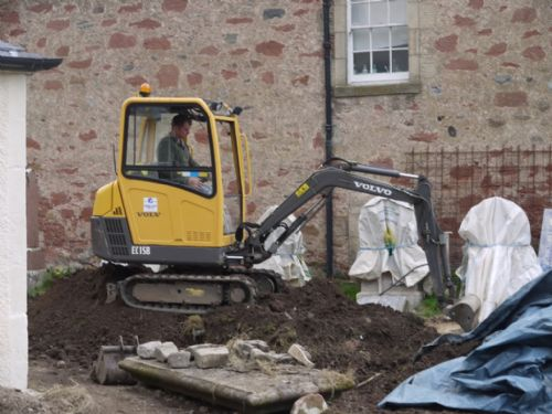 digger in the East Church, Cromarty