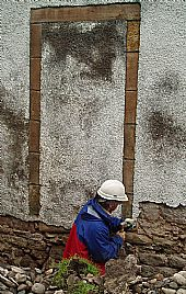 paddy removing harling near old south wall doorway