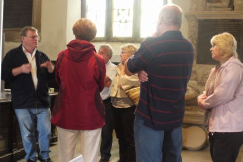 Dave Adgar shows visitors Old Holy Trinity Church, Wentworth