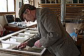 Mark Stephens repairing East Church, Cromarty windows